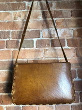 Load image into Gallery viewer, Kingspier Vintage - Hand tooled leather saddle bag with leather stitching, adjustable strap and brass front clasp.