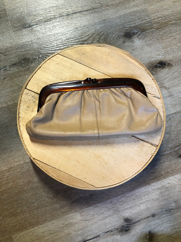 Beige leather clutch with amber bakelite style clasp. Made in Italy.