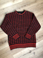 Load image into Gallery viewer, Hand knit black and red heritage print wool sweater. Made in Canada. Size L/XL.
