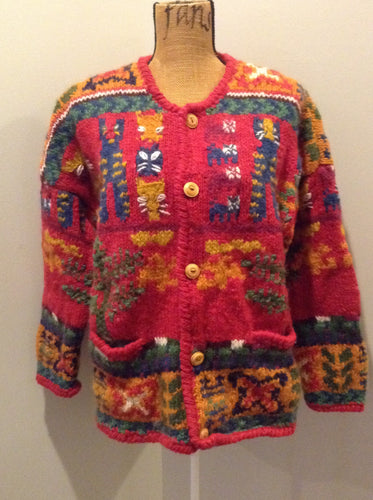 Express Tricot hand knit wool cardigan with multi coloured cat design, buttons and pockets. Size medium/ large.