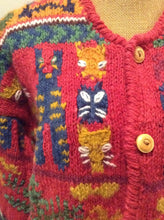 Load image into Gallery viewer, Kingspier Vintage - Express Tricot hand knit wool cardigan with multi coloured cat design, buttons and pockets. Size medium/ large.