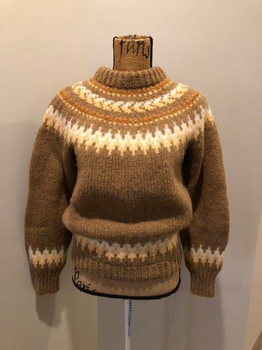 Handknit wool lopi sweater with browns, cream and yellow design. Made in Scotland. Size small/ XS.