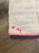 "Load image into Gallery viewer, Kingspier Vintage - Handmade lightweight wool lap blanket with hot pink stitching and ""AM"" monogram stitched on one corner."