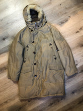 Load image into Gallery viewer, Kingspier Vintage - Richlu down-filled parka in beige with zipper and button closures, fox fur trimmed hood for exceptionally cold conditions. This parka has leather reinforcement details, two flap pockets and two hand warmer pockets with knit inside cuffs and inside drawstring. Made in Winnipeg, Canada. Size large.