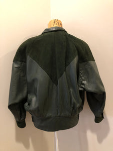 Kingspier Vintage - Bainton green leather jacket with green suede details, zipper and snap closures, slash pockets and black lining. Made in Canada. Size large.