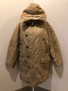 Kingspier Vintage - Richlu down-filled parka in beige with zipper and button closures, fox fur trimmed hood for exceptionally cold conditions. This parka has leather reinforcement details, two flap pockets and two hand warmer pockets with knit inside cuffs and inside drawstring. Made in Winnipeg, Canada. Size large.