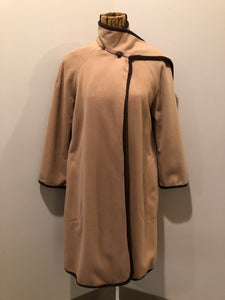 Kingspier Vintage - Handmade camel coloured cashmere cape with sleeves, attached scarf, patch pockets, two button closure at the collar and a full lining.