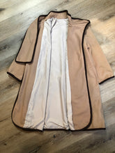 Load image into Gallery viewer, Kingspier Vintage - Handmade camel coloured cashmere cape with sleeves, attached scarf, patch pockets, two button closure at the collar and a full lining.