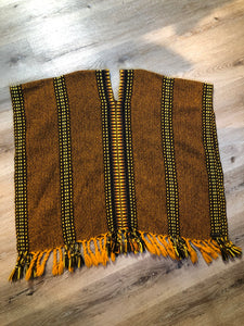 Kingspier Vintage - Vintage wool poncho with yellow, orange and brown designs and tassels on the bottom