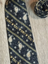 "Load image into Gallery viewer, Kingspier Vintage - Bill Blass tie with black, grey, yellow and white paisley design. Fibres unknown.  Length: 60"" Width: 4""  This tie is in excellent condition."