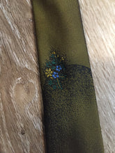 "Load image into Gallery viewer, Kingspier Vintage - Parklane polyester tie in olive and black with a unique flower design.  Length: 56"" Width: 2.25""   This tie is in excellent condition."