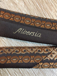"Kingspier Vintage - Albersia brown and orange 70's pattern tie. Fibres unknown.  Length: 52.25""  Width: 2.25""   This tie is in excellent condition."