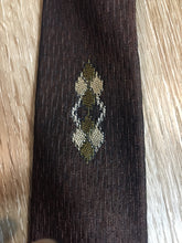 "Load image into Gallery viewer, Kingspier Vintage - Fifth Avenue brown tie with white, green and brown diamond motif. Fibres unknown.  Length: 57""  Width: 2.25""   This tie is in excellent condition."