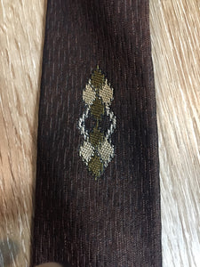 "Kingspier Vintage - Fifth Avenue brown tie with white, green and brown diamond motif. Fibres unknown.  Length: 57""  Width: 2.25""   This tie is in excellent condition."