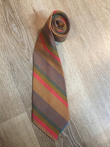 "Kingspier Vintage - Seconds brown, orange, green and blue striped tie. Fibres unknown.  Length: 56""  Width: 4.25""   This tie is in excellent condition."