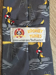 "Kingspier Vintage - Looney Toones grey 100% silk tie with Daffy Duck Print. Made in Italy.  Length: 61.5""  Width: 3.75""   This tie is in excellent condition."