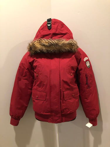 "Roots down-filled bomber jacket in red with faux fur trimmed hood, zipper closure, flap pockets and slash pockets, ""Stay Warm Eh"" written on the inside pocket. Size medium."