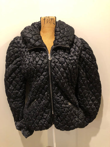 TWF black quilted nylon puffer jacket with synthetic insulation, oversized collar, zipper closure and zip slash pockets. Size medium.