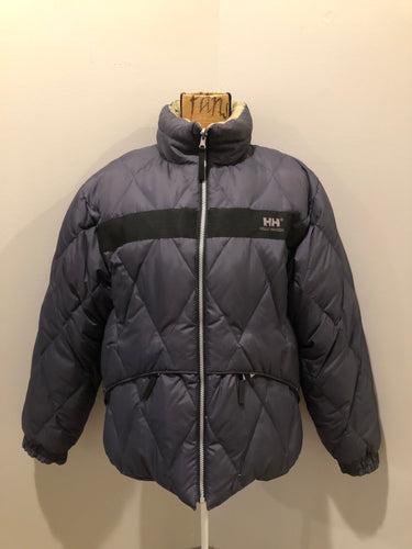 Helly Hansen reversible charcoal and beige down-filled puffer jacket. This jacket is quilted with zipper closure and zip pockets on both sides. Size Large.
