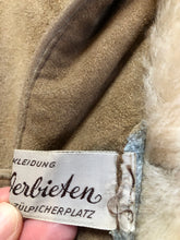 Load image into Gallery viewer, Kingspier Vintage - Karl Inderbieten shearling coat with light brown suede on the outside and soft fur on the inside. This coat is double breasted with button closures, shearling trim and a unique choker detail with brass clasp at the collar. Size medium/ large