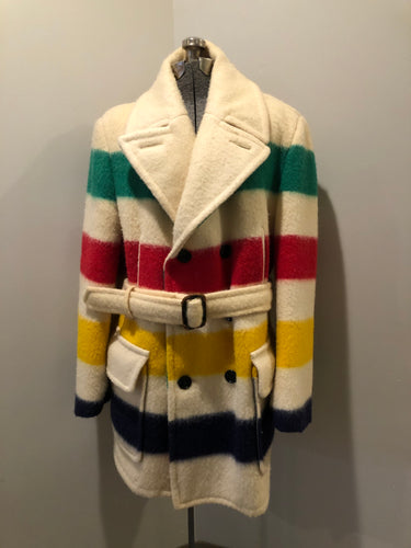 Genuine Hudson's Bay Company point blanket coat in the iconic multistripe colours. The coat features flap pockets and hand warmer pockets, double breasted button closures and belt. Made in Canada. Men's size 46.