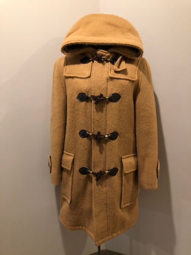 Deadstock Hudson's Bay Company duffle coat in camel with wooden toggles, flap pockets, zipper closures and hood.