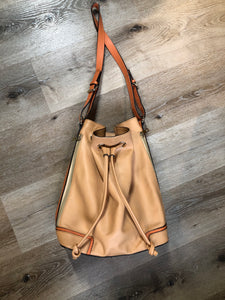 "KGB Orange and peach leather bucket bag with drawstring top closure, adjustable strap and side zip pockets.  Length - 11.5"" Width - .5.5"" Height - 13.5"" Strap - 32"" - 29""  This purse is in great condition with some wear in the strap."