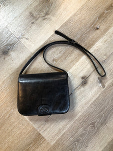 "Kingspier Vintage - Stephane black leather crossbody bag with adjustable strap five compartments, two with zippers magnetic snap front closure.  Length - 7.5"" Width - .2.5"" Height - 5.5"" Strap - 47"" - 45.5""  This purse is in excellent condition."