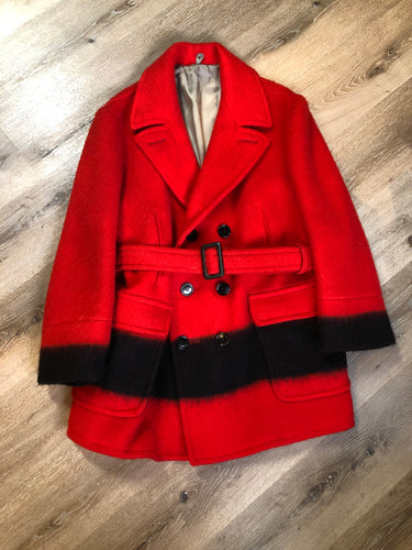 Genuine Hudson's Bay Company point blanket coat in red with thick black stripe. The coat features flap pockets and hand warmer pockets, double breasted button closures and belt. Made in Canada. Mens size 48.
