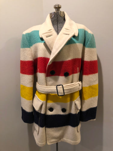 Genuine Hudson's Bay Company point blanket coat in the iconic multi stripe colours. The coat features flap pockets and hand warmer pockets, double breasted button closures and belt. Made in Canada. Mens size 50.