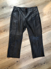 "Load image into Gallery viewer, Danier straight leg cropped pants with side zipper, rayon blend lining and zipper detail on the bottom legs on each side. Women's size 8.  Waist - 31""  Outseam - 32"" Inseam - 21"" Rise - 10""  Pants are in excellent condition with some minor wear."