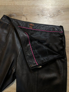 "Danier straight leg cropped pants with side zipper, rayon blend lining and zipper detail on the bottom legs on each side. Women's size 8.  Waist - 31""  Outseam - 32"" Inseam - 21"" Rise - 10""  Pants are in excellent condition with some minor wear."