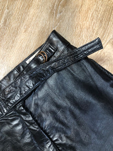 Kingspier Vintage - Rive Droite blsck leather highrise pants with tapered leg, zip side pockets and belt detail. Size 10