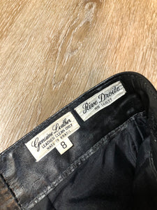 Kingspier Vintage - Rive Droite blsck leather highrise pants with tapered leg, zip side pockets and belt detail. Size 12