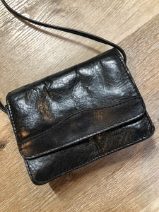 Kingspier Vintage - Small black leather crossbody bag with skinny strap, snap closure, loop to attach to a belt and a paisley lining.