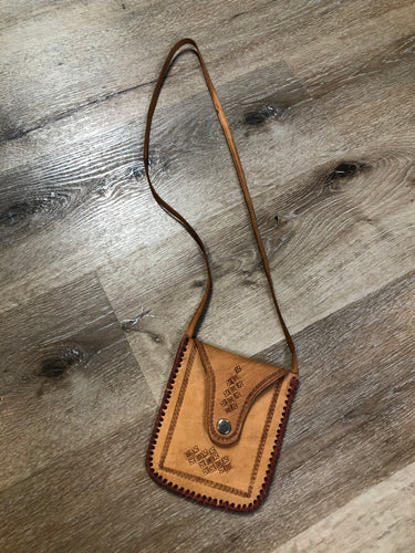 Kingspier Vintage - Small tan leather crossbody pouch with snap front closure, leather stitching and decorative tooling.
