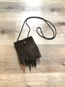 Small dark brown suede crossbody bag with fringe details.