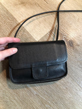 "Load image into Gallery viewer, Small black leather crossbody bag with  two inside compartments and a small inside mirror.  Length - 6.5"" Width - 2"" Height - 5"" Strap - 45""  This purse is in great condition."