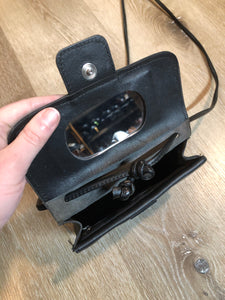 "Small black leather crossbody bag with  two inside compartments and a small inside mirror.  Length - 6.5"" Width - 2"" Height - 5"" Strap - 45""  This purse is in great condition."