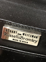 Load image into Gallery viewer, Kingspier Vintage - Stuart Weitzman for Russell and Bromley black crossbody bag with sparkle details on the strap, flap top with snap closure. Fibre content unknown.
