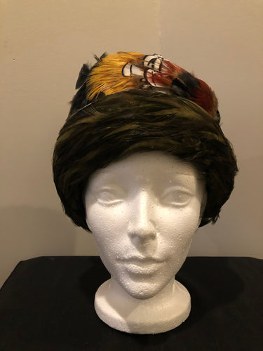 "Kingspier Vintage - Jacqueline Fashion Hats green felt hat with red, orange, black and white feathers. Made in Toronto.  Circumference - 21""  Hat is in excellent vintage condition."
