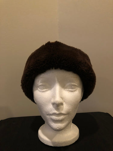 "Kingspier Vintage - Brown suede and shorn beaver hat with knit ear warmers and quilted lining.  Circumference - 20""  Hat is in good condition."
