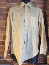 Load image into Gallery viewer, Kingspier Vintage - Vintage Arrow button up shirt in salmon, black, mustard and orange design. Made in Canada. Mens size medium.