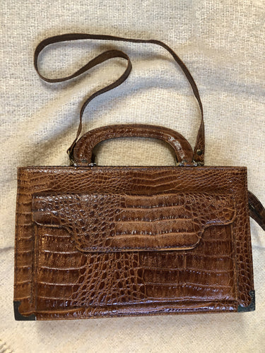"Kingspier Vintage - Vintage Veneto reptile skin satchel with front pocket, removable shoulder strap and two large inside compartments. Made in Italy.  Length - 14"" Width - 3.5"" Height - 9"" Strap - 33""  This purse is in excellent condition."
