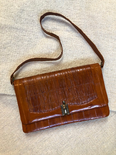 "Kingspier Vintage - Vintage satchel in very soft caramel colour leather with gathered leather details, a unique front clasp, brass hardware and three inside compartments.   Length - 12"" Width - 1"" Height - 7.5"" Strap - 30.5""  This purse is in excellent condition."