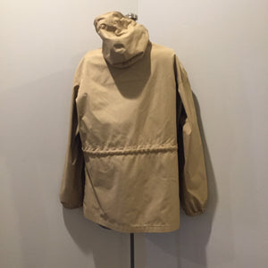 Kingspier Vintage - 1960s Vintage Zero King storm jacket in beige with hood, zipper closure, four flap pockets on the front, drawstring at the waist. Made in USA. Size 44.