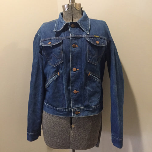 Kingspier Vintage - Vintage Wrangler medium wash denim jacket with iconic wrangler stitching, button closures, flap pockets on the chest and hand warmer pockets. Size medium. Made in USA.