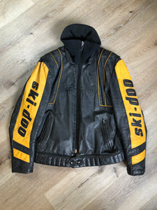 Kingspier Vintage - Bombardier Ski-Doo black and yellow leather jacket by Drospo with knit collar, zipper closure, zip pockets, quilted lining and one inside zip pocket. Made in Canada