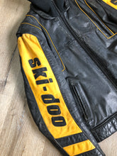 Load image into Gallery viewer, Kingspier Vintage - Bombardier Ski-Doo black and yellow leather jacket by Drospo with knit collar, zipper closure, zip pockets, quilted lining and one inside zip pocket. Made in Canada