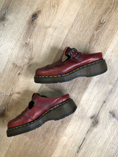 Vintage Doc Martens red smooth leather slip-on Mary Janes with Polley T-Bar strap and adjustable buckle, cap toe and air-cushioned sole. Made in England.  Size UK 6 or US 8 women's   *Shoes are in great condition with some minor wear in leather upper and soles.
